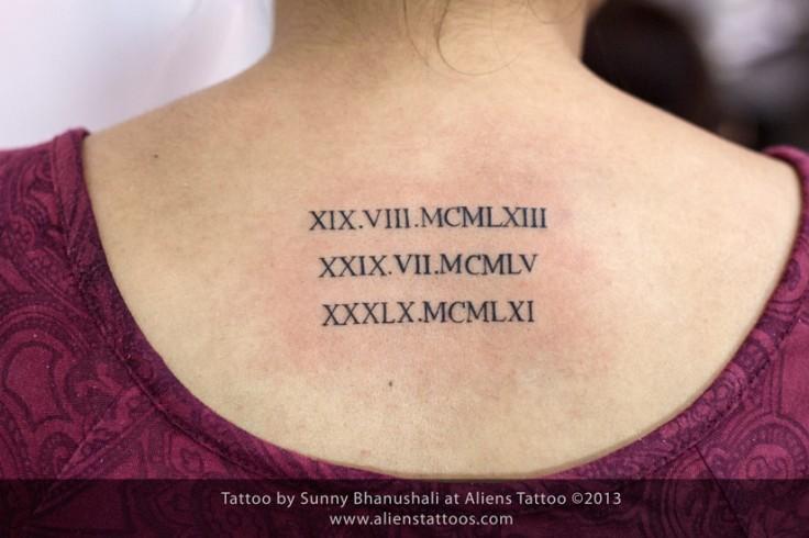 Roman DOB tattoo